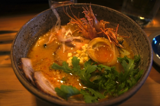 Baby spot prawn miso ramen with ground pork belly, soy marinated egg, corn, torpedo onions, wood ear mushrooms, and shungiku